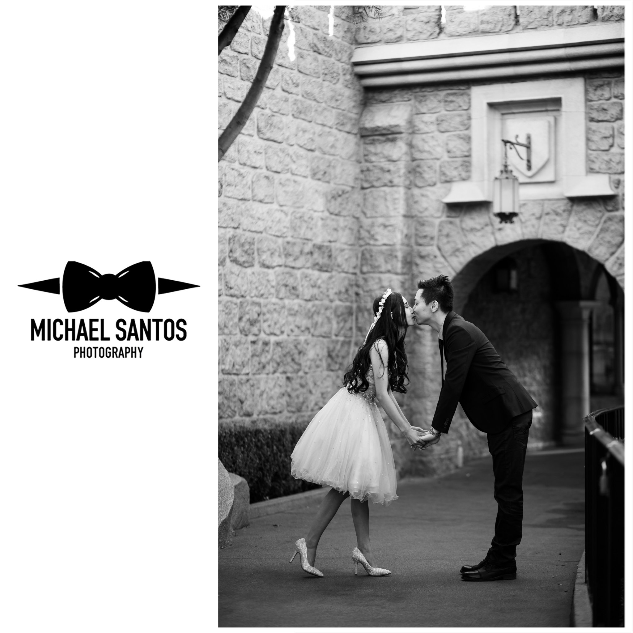 couple kissing during engagement session at disneyland