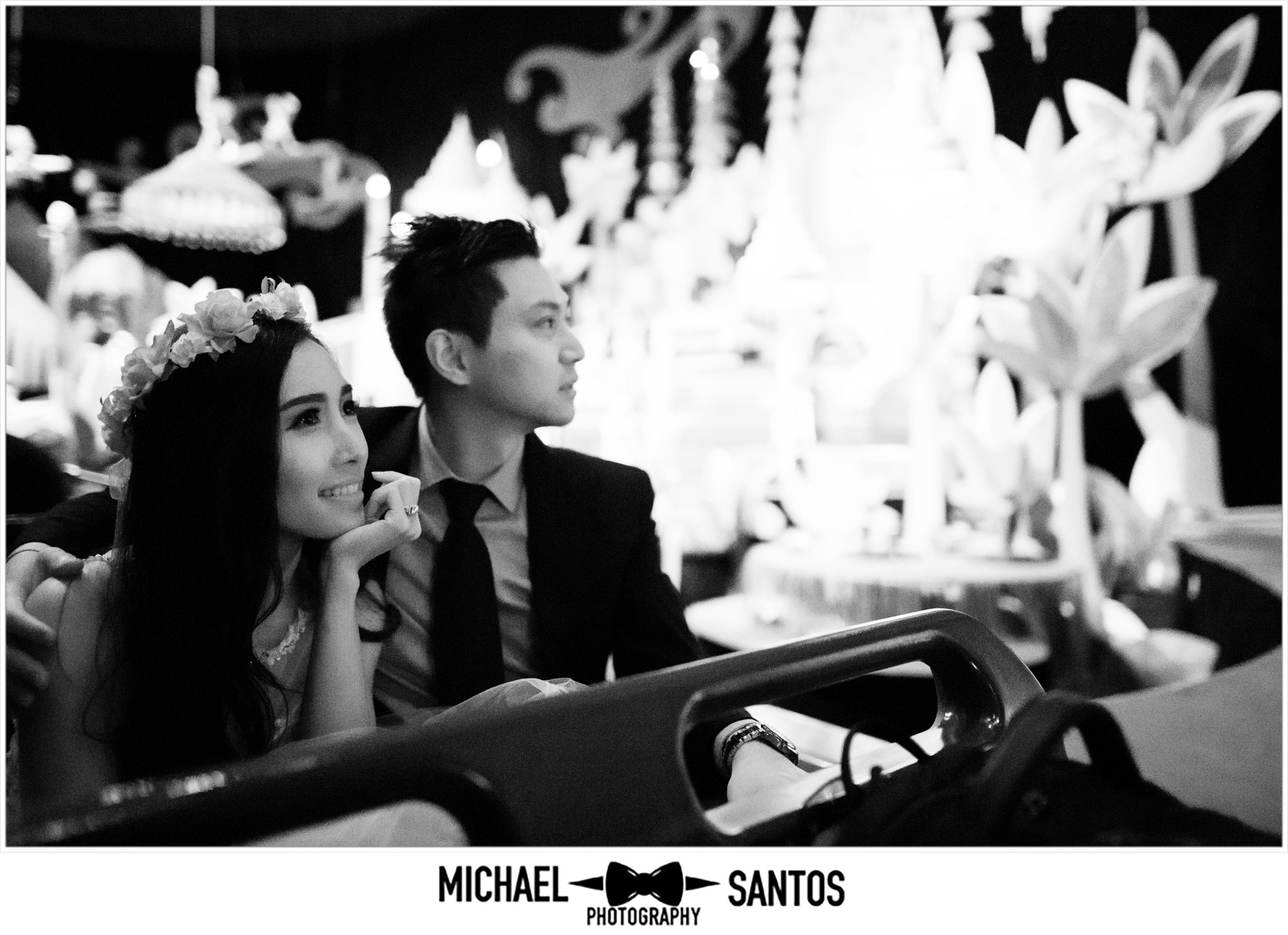 couple on its a small world during engagement session at disneyland